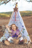 Child girl in decorative hovel on the nature Royalty Free Stock Images