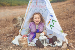 Child girl in decorative hovel on the nature Royalty Free Stock Photos
