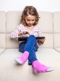 Child girl digital tablet Stock Image