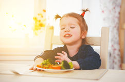 Child girl does not like and not want to eat vegetables Stock Photos