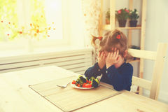 Child girl does not like and not want to eat vegetables Royalty Free Stock Photography