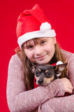 Child girl with dog in Christmas portrait Royalty Free Stock Photos