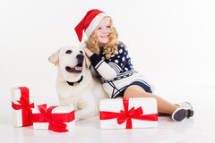 Child girl with dog are sitting in studio Stock Photos