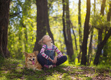 Child girl and the dog Royalty Free Stock Photo