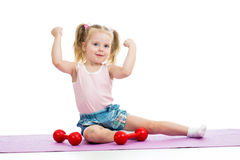 Child doing exercises with weights Royalty Free Stock Photo
