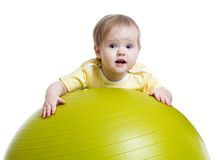 Child girl doing fitness exercise with fitness Stock Photos