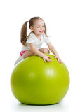Child girl doing fitness exercise with fitness Royalty Free Stock Images