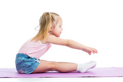 Kid girl doing fitness exercises Stock Photos
