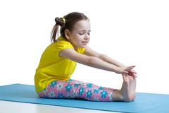 Child girl doing fitness exercises Royalty Free Stock Photo