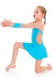 Child girl doing fitness exercises Stock Photos