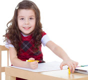 Child girl drawing with colourful pencils Royalty Free Stock Photography