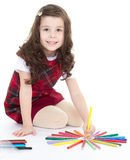Child girl drawing with colourful pencils Royalty Free Stock Photos