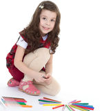 Child girl drawing with colourful pencils Stock Photography