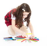Child girl drawing with colourful pencils Royalty Free Stock Image