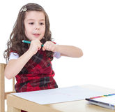 Child girl drawing with colourful pencils Stock Photo