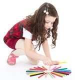 Child girl drawing with colourful pencils Royalty Free Stock Photo