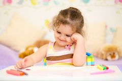 Child girl drawing in nursery Royalty Free Stock Image