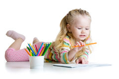 Child girl drawing with pencils in nursery Stock Photography