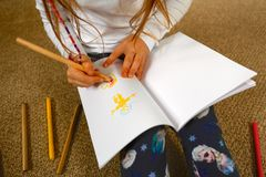Child/Girl Drawing Picture for Mother's Day Stock Photos