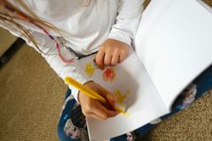 Child/Girl Drawing Picture for Mother's Day Stock Images