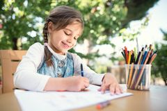 Child Girl Drawing Picture Outdoors. In Summer royalty free stock photos