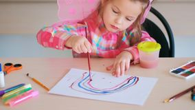 Child girl drawing school talent. Concept. art tutorials. happy childhood royalty free stock photo