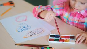 Child girl drawing school talent. Concept. art tutorials. happy childhood stock photos