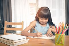 Child girl drawing on the table stock image