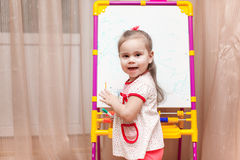 Child girl drawing on white board Royalty Free Stock Images
