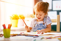 Child  girl draws with colored pencils Stock Photography