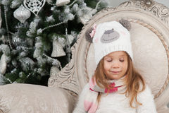 Child girl dreaming with closed eyes, Christmas tree Royalty Free Stock Photo