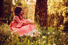 Child girl dressed as fairytale princess in summer forest Stock Photo