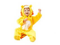 Child girl,dressed in lion carnival suit, isolated on white background. Baby zodiac - sign Leo. The concept of childhood and holiday royalty free stock photos
