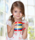 Child girl drink mug morning tea healthy lifestyle. Stock Photos