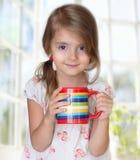 Child girl drink mug morning tea healthy lifestyle. Stock Photos