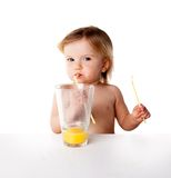 Child girl drinking juice isolated on white Royalty Free Stock Photos