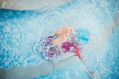 child girl drowning in pool Royalty Free Stock Photo