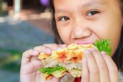 Child girl eat waffles pork Stock Image
