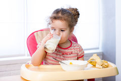 Child girl eating corn flakes with milk Royalty Free Stock Images