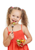 Child girl eating with healthy food vegetables Stock Photos