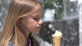 Child, Girl Eating Ice Cream In Park on Hot Torrid Summer Day, Closeup View 4K stock video footage
