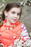 Child girl enjoying blossom. Pretty child girl and spring cherry blossom Royalty Free Stock Images