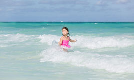 Child girl enjoying her swimming time in Atlantic ocean at Santa Maria Cuban island Royalty Free Stock Photo