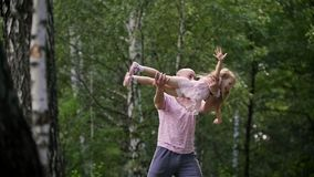 Child girl with father in park - daddy is spinning her Little Girl, slow-motion stock video