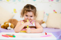 Child girl with felt-tip pen at home Stock Image