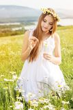 Child girl at field with mountains view Royalty Free Stock Photography
