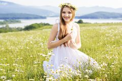 Child girl at field with mountains view Stock Photo