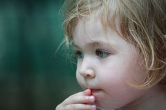 Child girl with a finger on her lips Royalty Free Stock Image