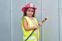 Child girl in fireman costume Royalty Free Stock Photo