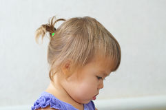 Child girl first hair style - tiny tail, profile of baby girl ch Royalty Free Stock Image